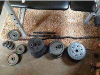 Weights bench and 80 kegs of weights