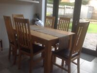 Oak dining table (150cm X 90cm)and 6 oak/leather chairs. Rhiwbina area