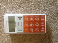 Big button mobile phone. Boxed with manual and charger, no SIM card.