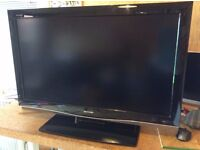 """Sharp Aquos 37"""" LCD TV including slimline flat wall bracket, original stand and remote control."""