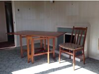 Compact folding dining room table