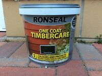 2 unopened 5 litre tubs of Ronseal forest green fence paint.