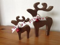 christmas star gazing reindeer decorations mother and baby copper brown red bells santa ribbon