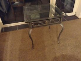 Large heavy side table in chrome, glass top