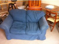 Two seater sofa with loose covers