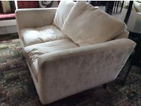 Luxurious cream velvet Laura Ashley two seater sofa 1year old