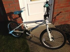 Girls age 10 bike white and pale blue detail bunny hop bars