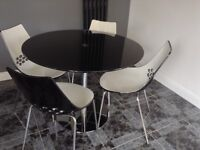 Black glass round table + 4 chairs