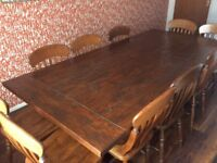 Large 10 seater oak dining table and chairs