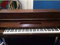 School piano. Needs tuning but otherwise good condition.