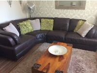 Large leather corner sofa and chair.