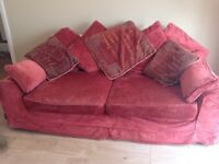Matching three seater and two seater sofas with removable washable covers in good condition