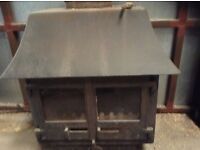 Woodburner with backboiler made by Woodwarm in the UK