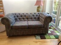 Small Chesterfield in blue fabric. One button missing and some cat scratch damage to one corner