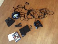 PS2 console & driving accessories