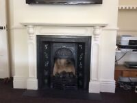 Gas fire cast iron surround and fireplace