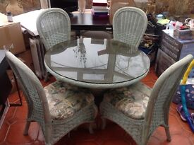 4 basket weave chairs and round table. £75