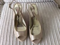 Nude open toe patent wedges