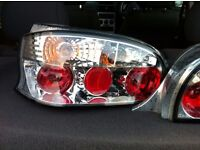 CITROEN SAXO LEXUS STYLE REAR LIGHTS WITH BULBS AND HOLDERS. VERY GOOD CONDITION