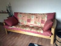 Futon couch-folds down flat to double bed