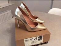 Silver heels uk size 2