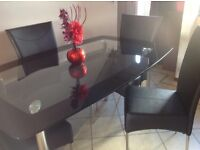 black smoke glass dinning table and chairs