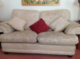 2 seater sofa from Laura Ashley in cream/ gold colour in good condion