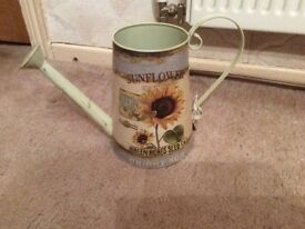 Decorative sunflower watering can