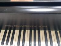 Baby grand PIANO. Black in good condition. Needs some love and attention
