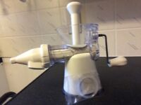 Hand operated juicer. Mueller make. Once used as not suitable for my weak hands.
