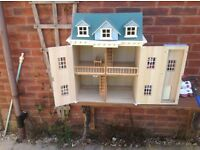 Dolls house with a selection of miniature furniture all in good condition