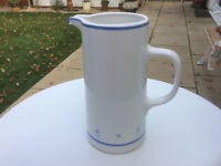White jug with blue band decoration