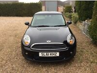 Mini first for sale , 2011 black 3 door 33000 miles
