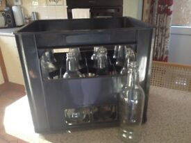 clear glass 500ml beer bottles and crate, plus other brewing items