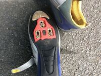Look cycling shoes complete with cleats and pedals.size nine u k .