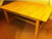 Large IKEA birch wood dining table with extension leaf. Seats 6. Good order.