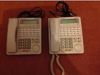 Two used Panasonic KX-T7433 24 button telephones