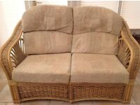 Cane furniture for sale. One two seater settee, footstool and two arm chairs