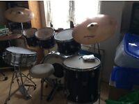 Drum kit stool and sticks ready to go