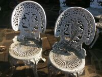 two vintage metal decorative chairs and table