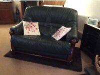 Bottle green leather armchair