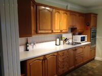 Kitchen units with solid oak doors - various sizes. Includes electric hob and extractor