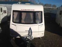 Swift cornich caravan with motormover and full size issabela awning top of the range 3 berth