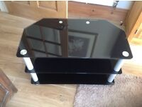 Black glass TV stand with silver legs £10