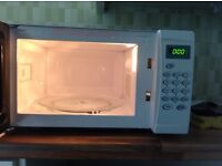 Cook works white microwave oven