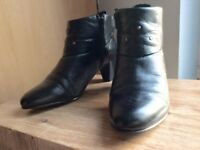 Size6 black leather ankle boots with 2 inch heels. Side zip closures & in mint condition .