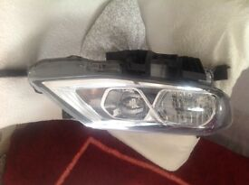 Nissan pulsar, headlamp, 2016 used, £155. Used closed to new