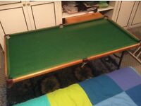 Junior snooker table on folding stand.