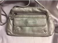 New unused small silver bag