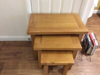 Solid oak nest of 3 tables in excellent condition